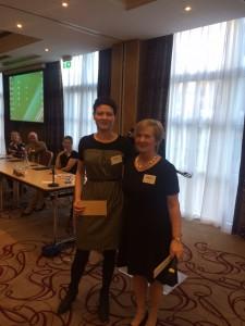 ISCM President Dr Eleanor McNamara congratulates poster competition winner Blaithnaid Mahon