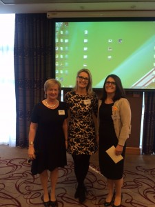 ISCM President Dr Eleanor McNamara congratulates joint oral presentation winners, Dr Breda Lynch and Dr Rachel Grainger