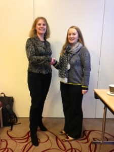 Dr Susan Knowles, ISCM President offers congratulations to Dr Laura Ryan, winner of the rapid fire poster presentation prize.