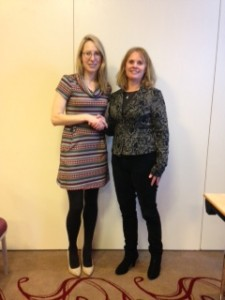 Dr Susan Knowles, ISCM President offers congratulations to Nicola Boran, winner of the poster presentation prize.